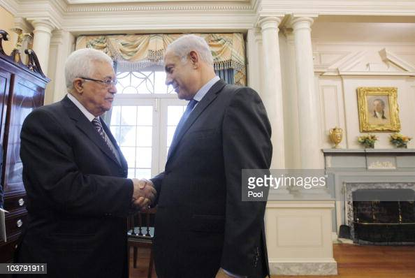 President of the Palestinian Authority Mahmoud Abbas shakes hands with Israeli Prime Minister Benjamin before holding direct peace talks at the State...