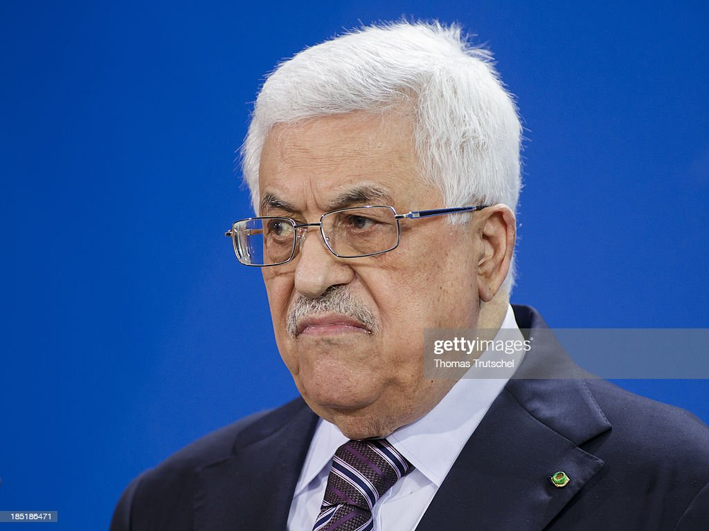 President of the Palestinian National Authority Mahmoud Abbas speak to the media following talks with German Chancellor Angela Merkel (not pictured) at the Chancellery on October 18, 2013 in Berlin, Germany. Abbas is currently in Europe partly to lobby the European Union against providing Israel funds for housing expansion in occupied territories.