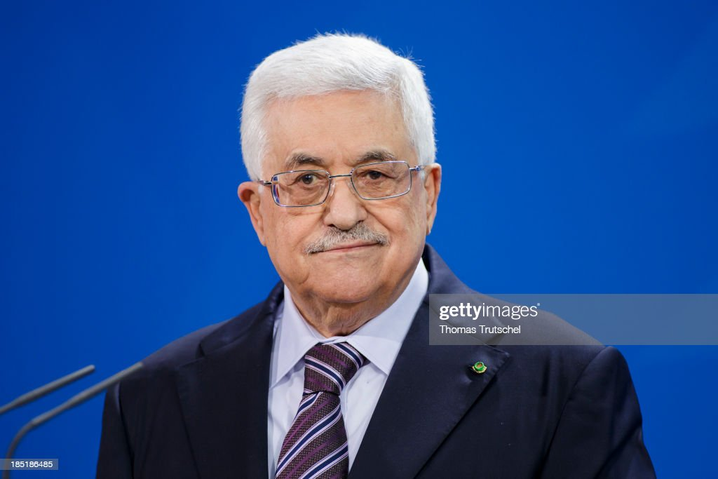 President of the Palestinian National Authority <a gi-track='captionPersonalityLinkClicked' href=/galleries/search?phrase=Mahmoud+Abbas&family=editorial&specificpeople=176534 ng-click='$event.stopPropagation()'>Mahmoud Abbas</a> speak to the media following talks with German Chancellor Angela Merkel (not pictured) at the Chancellery on October 18, 2013 in Berlin, Germany. Abbas is currently in Europe partly to lobby the European Union against providing Israel funds for housing expansion in occupied territories.