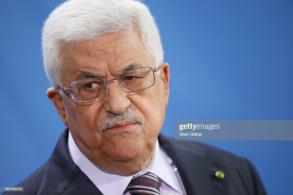 President of the Palestinian National Authority Mahmoud Abbas speaks to the media with German Chancellor Angela Merkel (not pictured) following talks at the Chancellery on October 18, 2013 in Berlin, Germany. Abbas is currently in Europe partly to lobby the European Union against providing Israel funds for housing expansion in occupied territories.