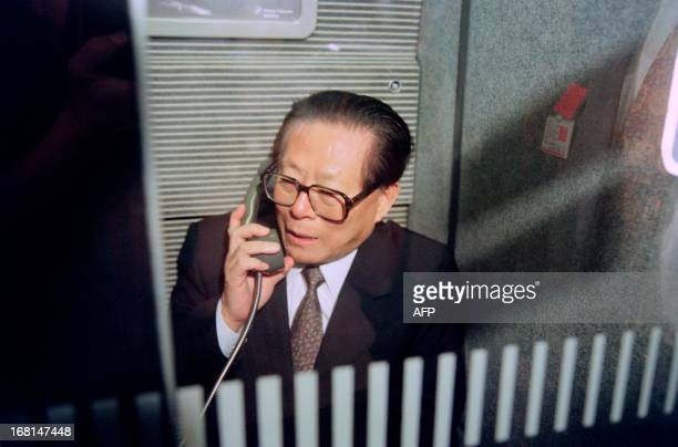 President of the People's Republic of China Jiang Zemin stands in the phone booth of the TGV on his way to visit the nuclear center of Blayais