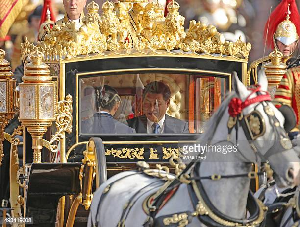President of The People's Republic of China Xi Jinping rides in the Diamond Jubilee State Coach along The Mall after the ceremonial welcome on Horse...