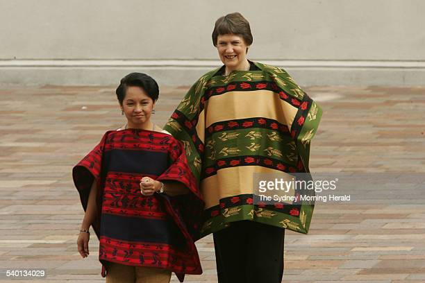 President of the Philippines Gloria Arroyo left and New Zealand Prime Minister Helen Clark attend the leaders' photograph session wearing the...