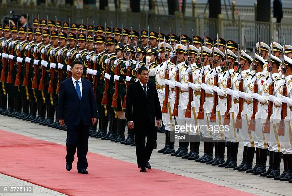 President of the Philippines Rodrigo Duterte and Chinese President Xi Jinping review the honor guard as they attend a welcoming ceremony at the Great...
