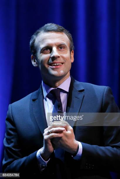 President of the political movement 'En Marche' and candidate for the French presidential election Emmanuel Macron speaks to the public on stage...