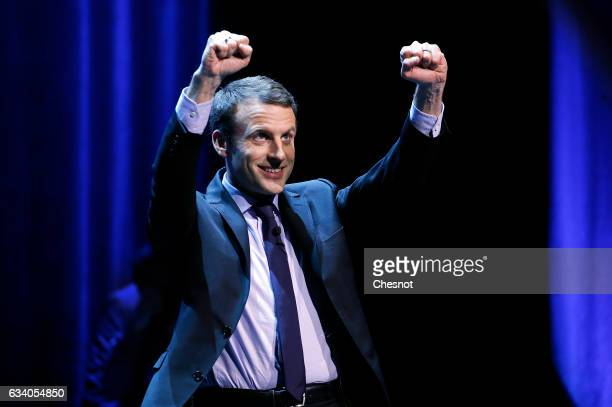 President of the political movement 'En Marche' and candidate for the French presidential election Emmanuel Macron gestures on stage during a...