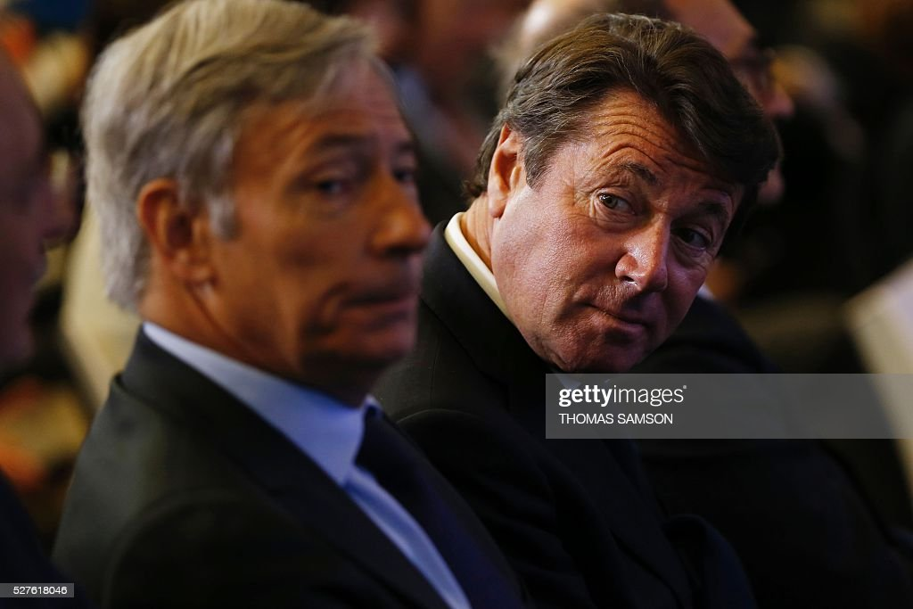 President of the Provence Alpes Cote d'Azur (PACA) region and Mayor of Nice Christian Estrosi (L) looks on as former French president and president of France's right-wing Les Republicains (LR) party Nicolas Sarkozy speaks after a meeting on environment, sea and energy, at the party's headquarters in Paris on May 3, 2016. SAMSON