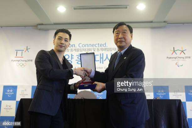President of the PyeongChang Organizing Committee for the 2018 Olympic and Paralympic Winter Games Lee HeeBeom and singer and songwriter Taeyang of...