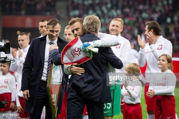 President of the PZPN Zbigniew Boniek hugs goalkeeper Artur Boruc before his last game for the national team during the international friendly soccer...