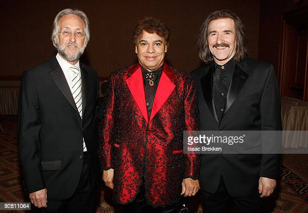 President of the Recording Academy Neil Portnow honoree Juan Gabriel and Chairman of the Latin Recording Academy Luis Cobos attends 2009 Person Of...