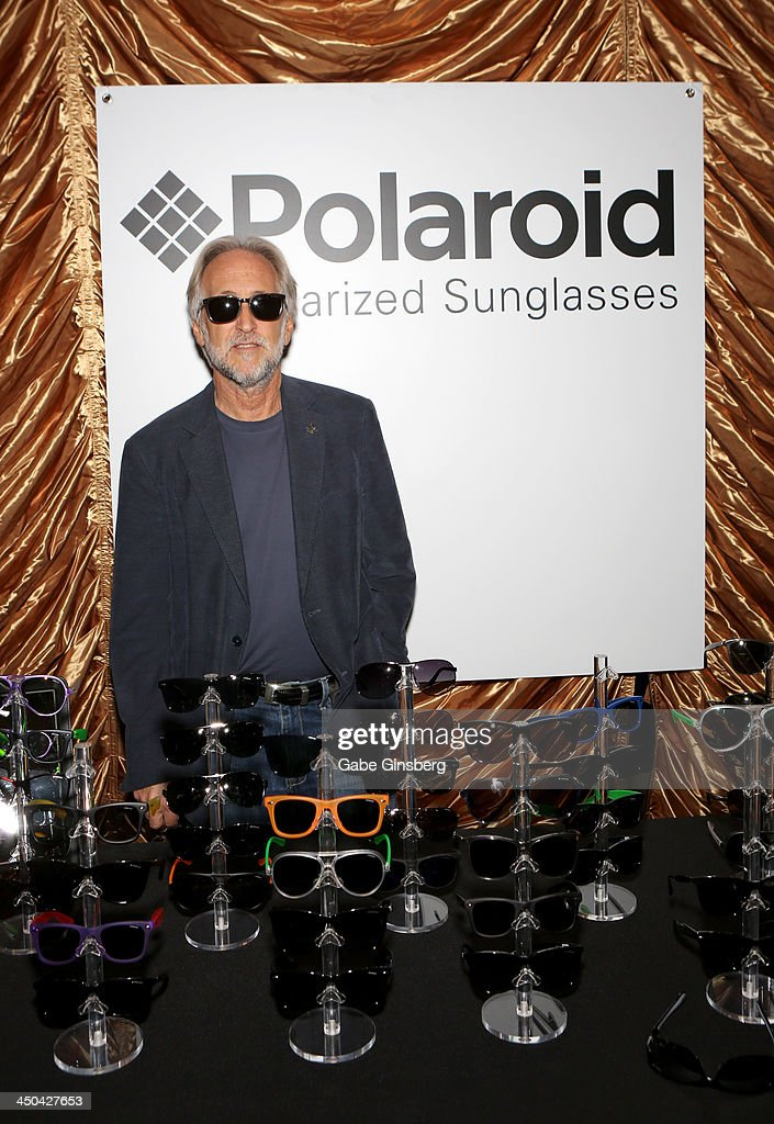 President of The Recording Academy <a gi-track='captionPersonalityLinkClicked' href=/galleries/search?phrase=Neil+Portnow&family=editorial&specificpeople=208909 ng-click='$event.stopPropagation()'>Neil Portnow</a> poses with Polaroid Polarized Sunglasses at a gift lounge during the 14th annual Latin GRAMMY Awards at the Mandalay Bay Events Center on November 18, 2013 in Las Vegas, Nevada.
