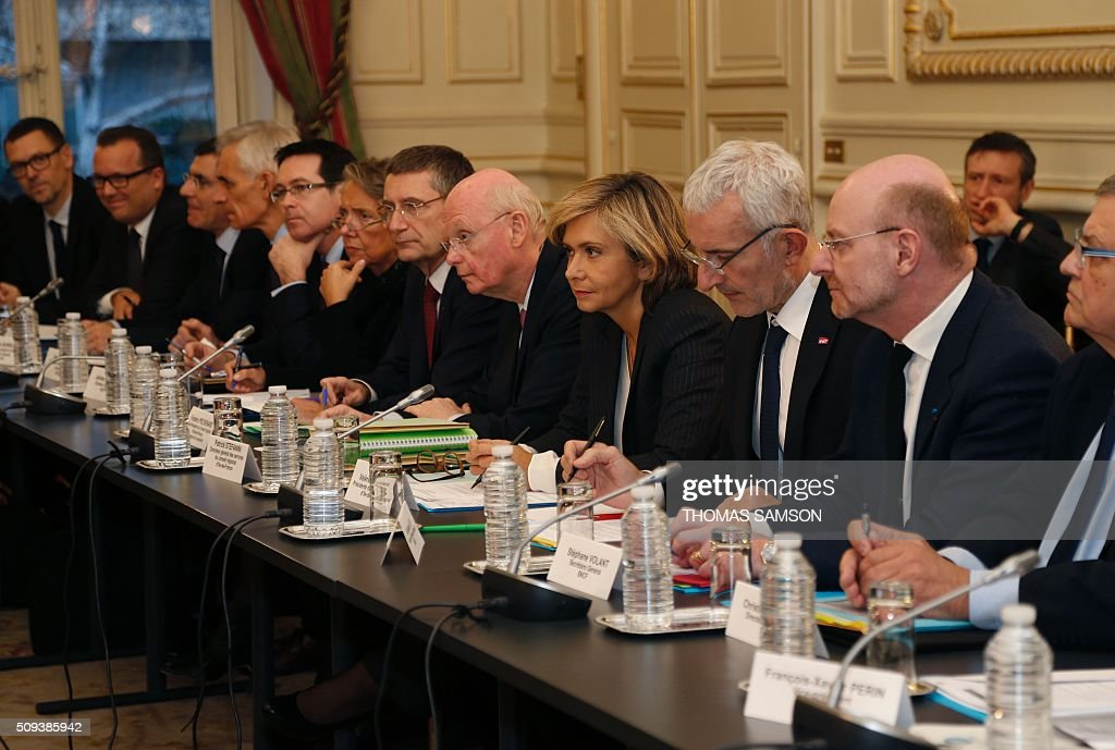 President of the regional council of the Ile-de-France region Valerie Pecresse ( 4th R), General Director of Ile-de-France's General Council Services Patrick Stefanini (5th R), Head of French state owned railway company sncf Guillaume Pepy (3rd R) and SNCF general secretary Stephane Volant (2nd R) attend a special meeting of the Public Transport National Security Committee on the Ile-de -France region at the Hotel Beauvau in Paris, on February 10, 2016. AFP PHOTO / THOMAS SAMSON / AFP / THOMAS SAMSON