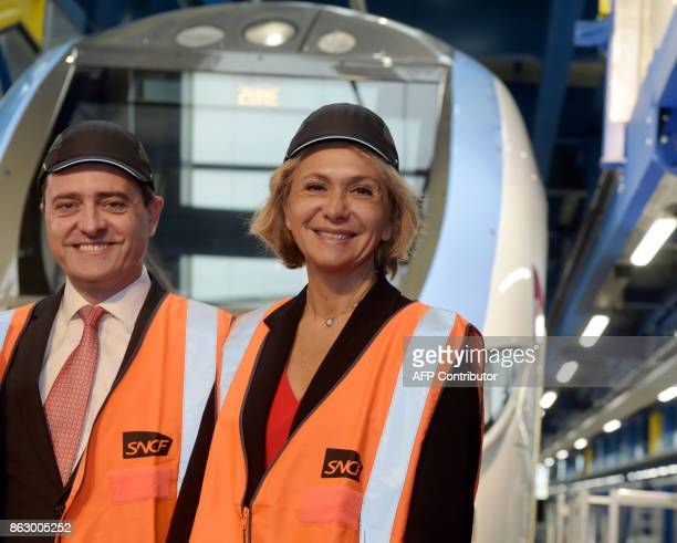 President of the Regional Council of the IledeFrance region Valerie Pecresse and Bombardier Transport France Chairman Laurent Bouyer pose in front of...