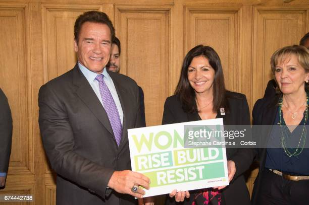 President of the Regions of Climate Action Arnold Schwarzenegger poses with the Mayor of Paris Anne Hidalgo during their meeting to sign a convention...