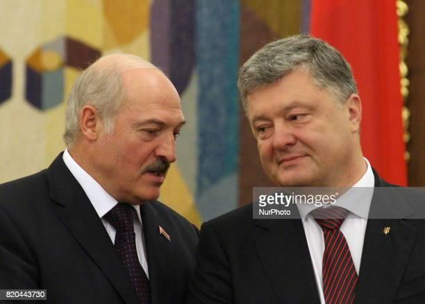 President of the Republic of Belarus Alexander Lukashenko on the left and Ukrainian President Petro Poroshenko on the right talking during an...