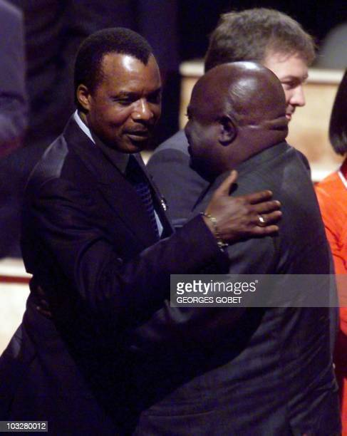 President of the Republic of Congo Denis SassouNguesso greets his Democratic Republic of Congo counterpart Laurent Desire Kabila 03 September 1999 in...