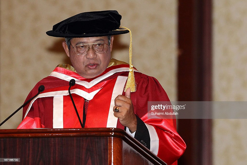 President of the Republic of Indonesia, Dr <a gi-track='captionPersonalityLinkClicked' href=/galleries/search?phrase=Susilo+Bambang+Yudhoyono&family=editorial&specificpeople=206513 ng-click='$event.stopPropagation()'>Susilo Bambang Yudhoyono</a> speaks on stage during the honorary doctorate conferment ceremony on April 22, 2013 in Singapore. It is reported that President <a gi-track='captionPersonalityLinkClicked' href=/galleries/search?phrase=Susilo+Bambang+Yudhoyono&family=editorial&specificpeople=206513 ng-click='$event.stopPropagation()'>Susilo Bambang Yudhoyono</a> will hold a Leaders' Retreat with Singapore Prime Minister Lee Hsien Loong as part of the visit.