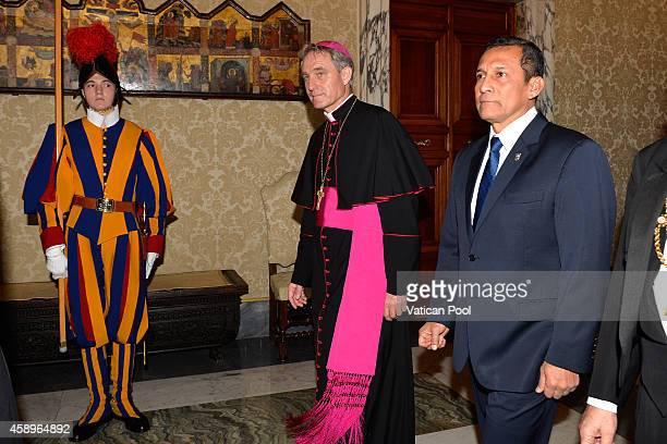 President of the Republic of Peru Ollanta Moises Humala Tasso flanked by Prefect of the Pontifical House and former personal secretary of Pope...