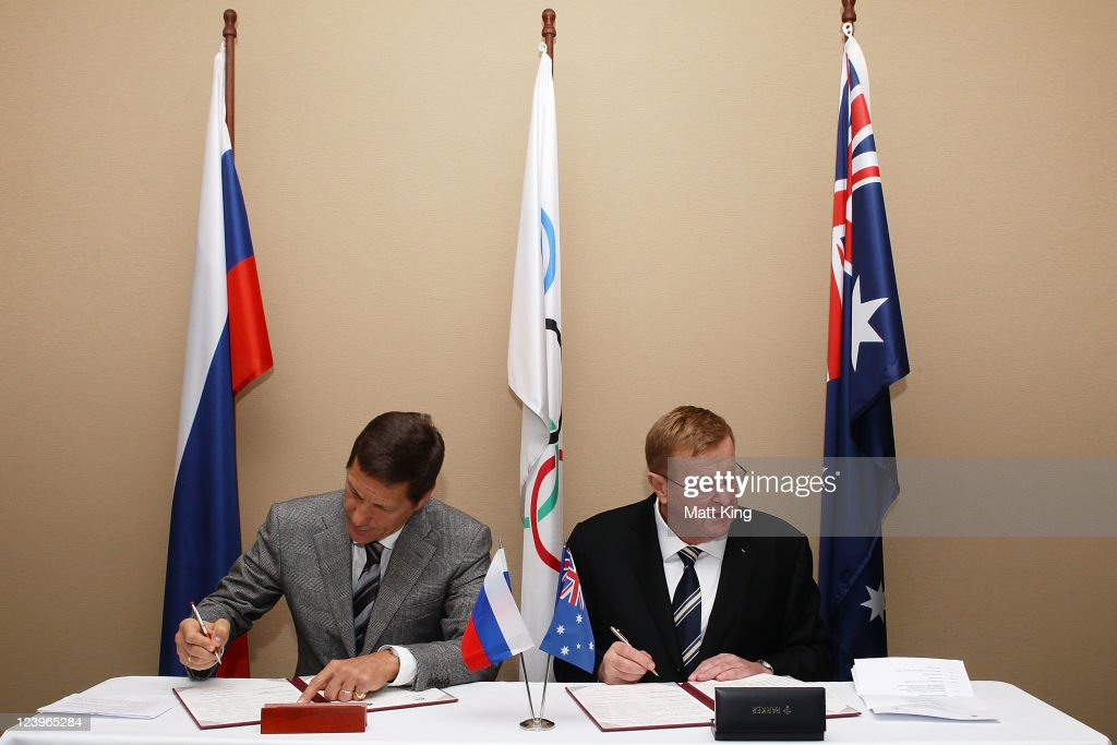 President of the Russian Olympic Committee Alexander Zhukov (L) and President of the Australian Olympic Committee <a gi-track='captionPersonalityLinkClicked' href=/galleries/search?phrase=John+Coates&family=editorial&specificpeople=233445 ng-click='$event.stopPropagation()'>John Coates</a> (R) sign a cooperation agreement between the Australian Olympic Committee (AOC) and the Russian Olympic Committee (ROC) at the Sofitel Hotel on September 7, 2011 in Sydney, Australia.