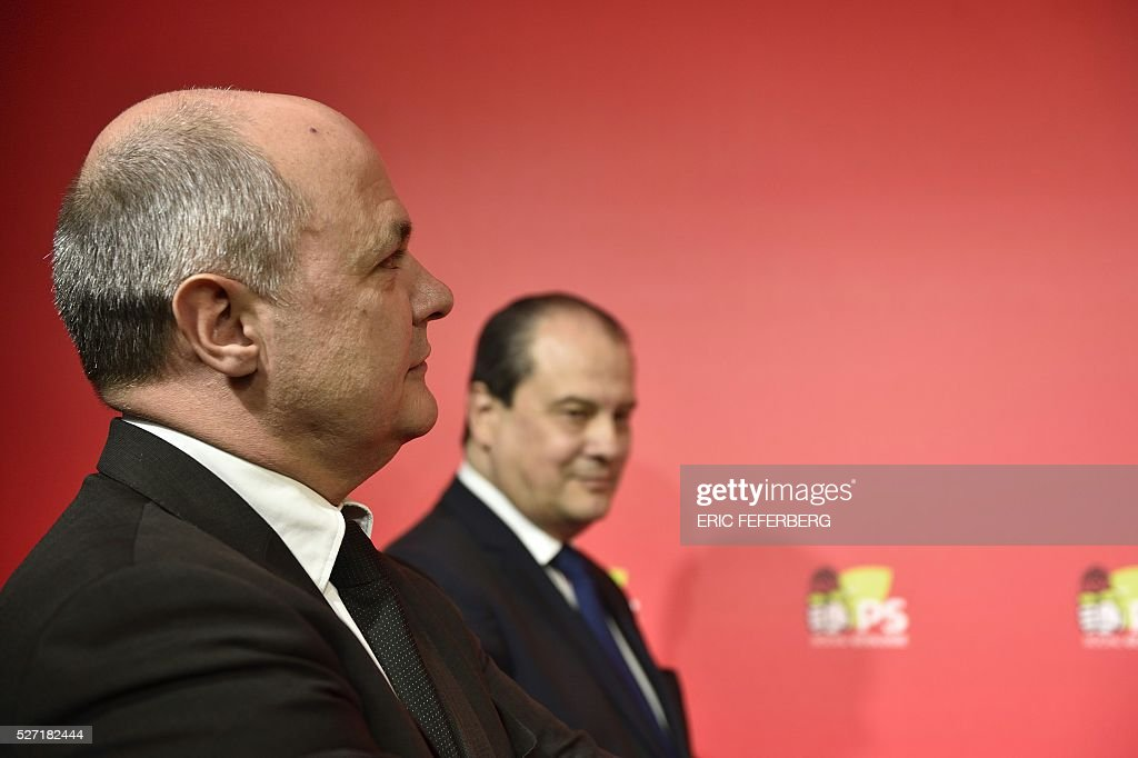 President of the Socialist parliamentary group at the French National Assembly, Bruno Le Roux (L) stands during a joint press conference with the first secretary of the French Socialist Party Jean-Christophe Cambadelis (R) on May 2, 2016 in Paris, during the launching of the party's campaign 'Du Progres en Plus' (Further Progress) aimed at highlighting the five-year term of the French Socialist president, and gather the Left a year ahead the 2017 presidential elections. / AFP / Eric FEFERBERG