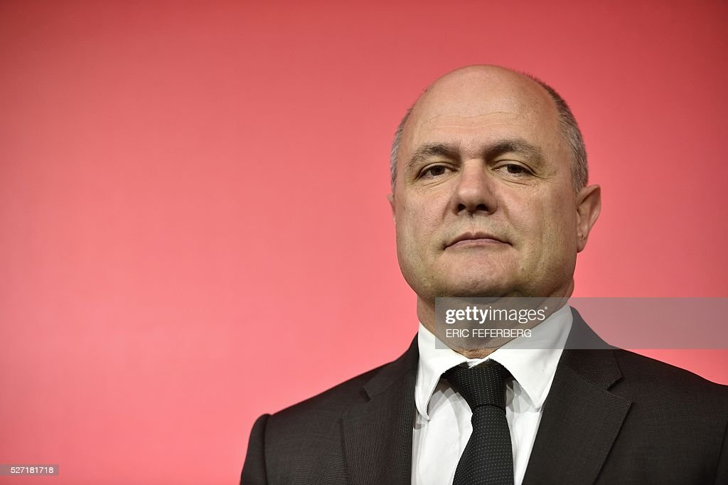 President of the Socialist parliamentary group at the National Assembly, Bruno Le Roux holds a joint press conference with the first secretary of the French Socialist Party on May 2, 2016 in Paris, during the launching of the party's campaign 'Du Progres en Plus' (Further Progress) aimed at highlighting the five-year term of the French Socialist president, and gather the Left a year ahead the 2017 presidential elections. / AFP / Eric FEFERBERG