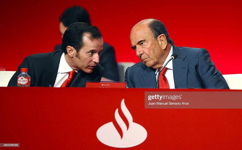 President of the Spanish bank Banco Santander, Emilio Botin speaks with Banco Santander's chief executive officer Javier Marin during the annual shareholders meeting at the Palacio Exposiciones on March 28, 2014 in Santander, Spain. As Spain tries to edge out of recession Banco Santander is looking for more growth as the euro zone's biggest bank.
