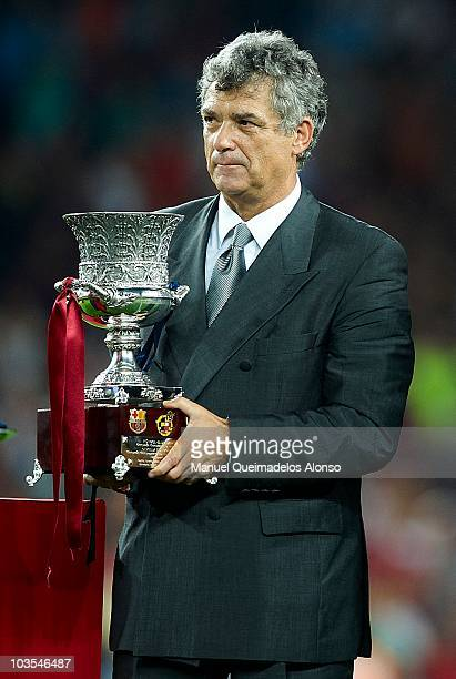 President of the Spanish Football Federation Angel Maria Villar with the trophy after the Spanish Supercopa second leg match between Barcelona and...