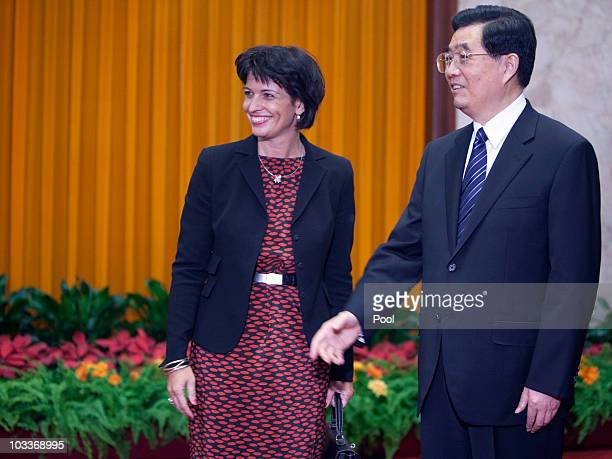 President of the Swiss Confederation Doris Leuthard and Chinese President Hu Jintao wait to meet Swiss delegates in the Great Hall of the People on...