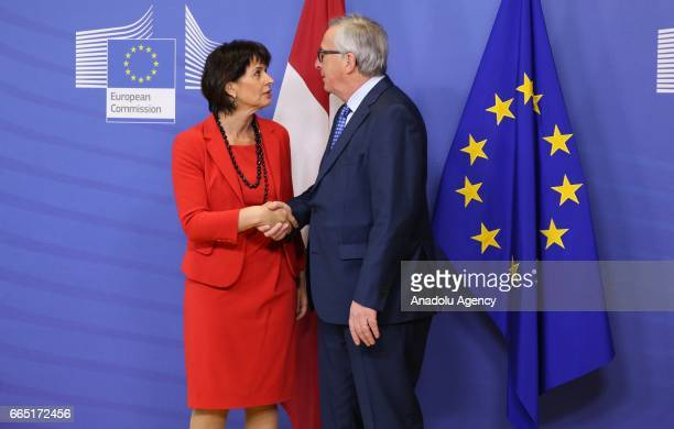 President of the Swiss Confederation Doris Leuthard and European Union Commission President Jean Claude Juncker shake hands during their meeting in...
