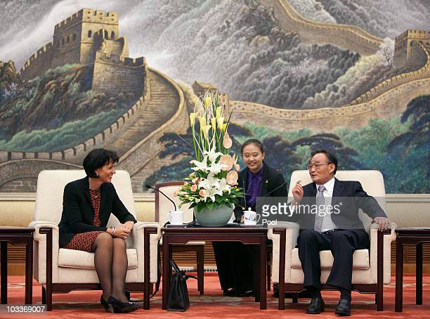 President of the Swiss Confederation Doris Leuthard chats with Chinese National People's Congress Chairman Wu Bangguo during a meeting in the Great...