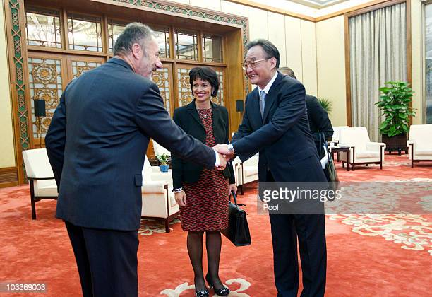 President of the Swiss Confederation Doris Leuthard looks on as Ambassador of Switzerland to China Blaise Godet shakes hands with Chinese National...