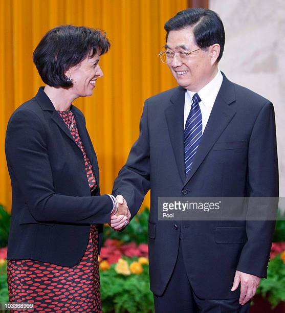 President of the Swiss Confederation Doris Leuthard shakes hands with Chinese President Hu Jintao in the Great Hall of the People on August 13 2010...