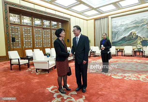 President of the Swiss Confederation Doris Leuthard shakes hands with Chinese National People's Congress Chairman Wu Bangguo during a meeting in the...
