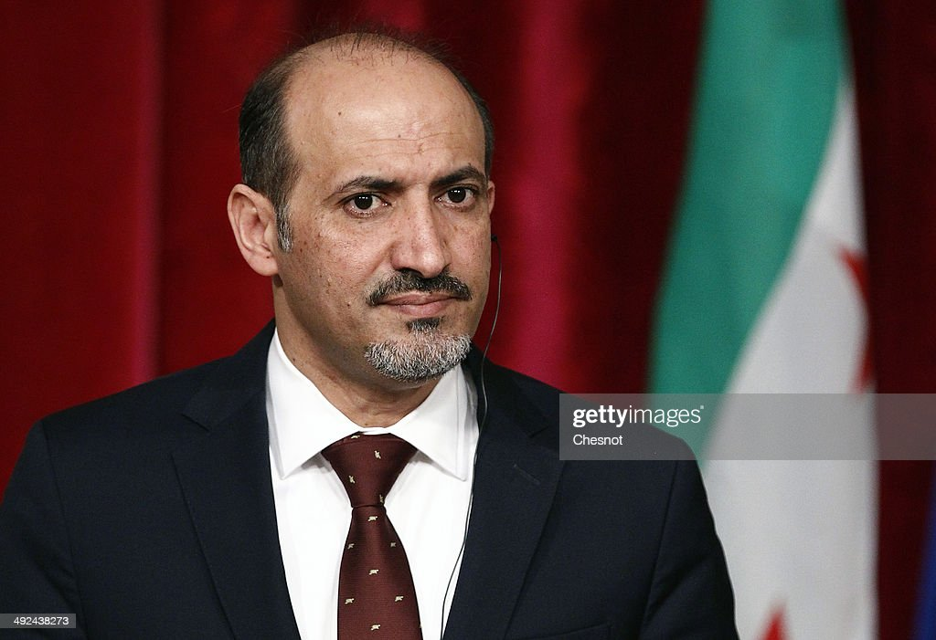 President of the Syrian National Coalition, <a gi-track='captionPersonalityLinkClicked' href=/galleries/search?phrase=Ahmad+Jarba&family=editorial&specificpeople=11168559 ng-click='$event.stopPropagation()'>Ahmad Jarba</a>, attends a press conference with French President Francois Hollande after a meeting on May 20, 2014 at the Elysee palace in Paris, France.