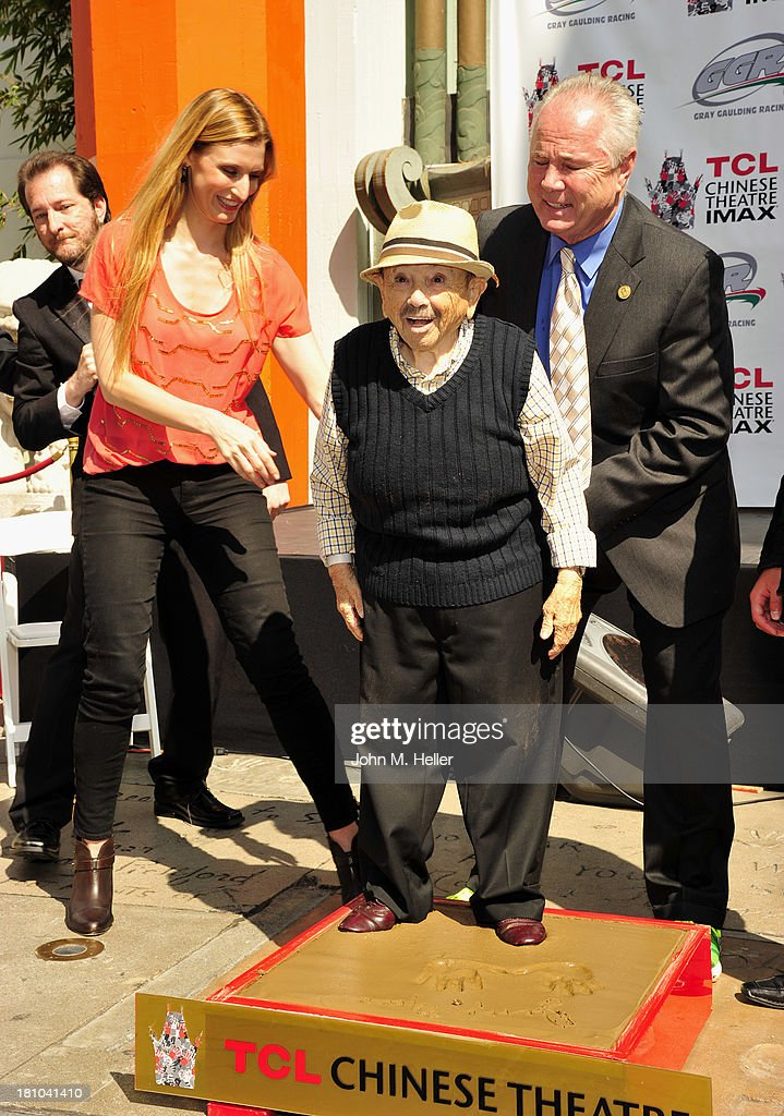 President of the TCL Chinese Theatre Alwyn Hight Kushner and 'The Lollipop Kid' actor <a gi-track='captionPersonalityLinkClicked' href=/galleries/search?phrase=Jerry+Maren&family=editorial&specificpeople=3637561 ng-click='$event.stopPropagation()'>Jerry Maren</a>, 93, Last Of The 'Munchkins' from 'The Wizard Of Oz' and Los Angeles City Councilman from the 4th district Tom LaBoonge attend the Handprint-Footprint Ceremony at the TCL Chinese Theatre on September 18, 2013 in Hollywood, California.