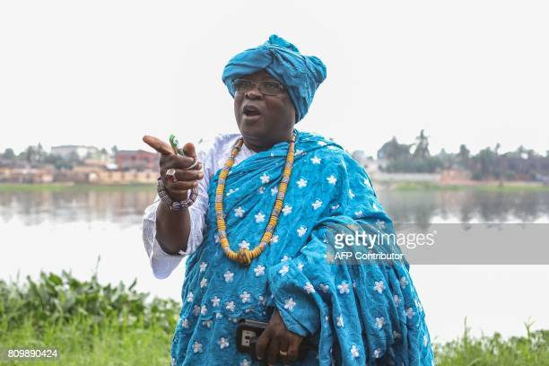 President of the Togolese confederation of the voodoo priests Togbui Gnagblondjro III gestures prior to a purification ceremony in Be a working class...