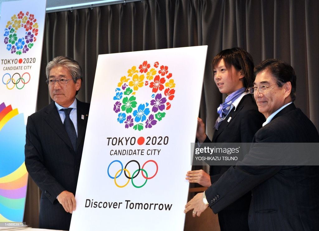 President of the Tokyo 2020 bid committee Tsunekazu Takeda, Japanese triathlon athlete Yuka Sato and Tokyo 2020 Bid Committee CEO Masato Mizuno unveil the new slogan 'Discover Tomorrow' and logo for the 2020 Summer Olympics bid in Tokyo on July 19, 2012. The slogan underpinned 'global inspiration and dynamic innovation', reflecting Japan's bid for the Games and Tokyo as a city, said bid committee president Tsunekazu Takeda. AFP PHOTO / Yoshikazu TSUNO
