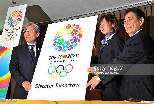 President of the Tokyo 2020 bid committee Tsunekazu Takeda Japanese triathlon athlete Yuka Sato and Tokyo 2020 Bid Committee CEO Masato Mizuno unveil...