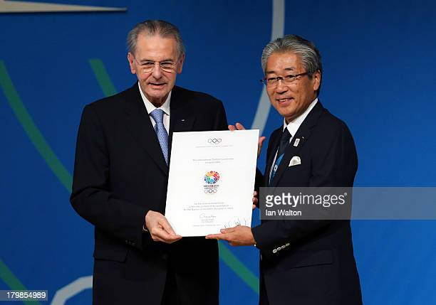 President of the Tokyo 2020 Committee Tsunekazu Takeda receives a diploma from President of the IOC Jacques Rogge during the Tokyo 2020 bid...