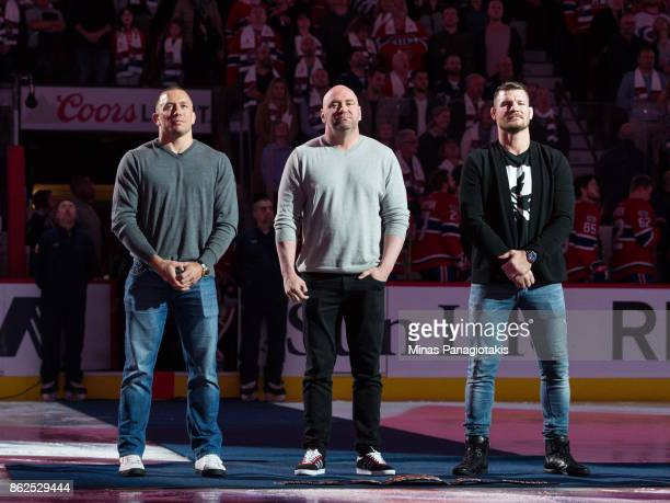 President of the UFC Dana White stands inbetween Georges StPierre and defending middleweight UFC champion Michael Bisping during the NHL game between...