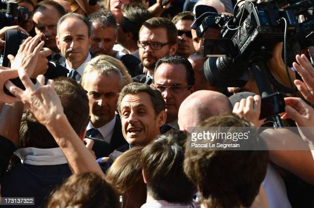 President of the UMP JeanFrancois Cope and former French President Nicolas Sarkozy departs from UMP headquarters after an extraodinaty meeting of UMP...