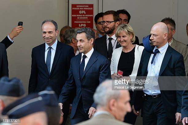 President of the UMP JeanFrancois Cope former French President Nicolas Sarkozy and Nadine Morano depart from UMP headquarters after an extraordinary...