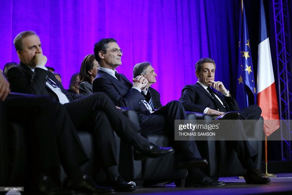 President of the UMP right-wing opposition party and former French President, <a gi-track='captionPersonalityLinkClicked' href=/galleries/search?phrase=Nicolas+Sarkozy&family=editorial&specificpeople=211375 ng-click='$event.stopPropagation()'>Nicolas Sarkozy</a> (R), President of the Hauts-de-Seine Departmental Council, <a gi-track='captionPersonalityLinkClicked' href=/galleries/search?phrase=Patrick+Devedjian&family=editorial&specificpeople=779301 ng-click='$event.stopPropagation()'>Patrick Devedjian</a> (2nd L) and Senator <a gi-track='captionPersonalityLinkClicked' href=/galleries/search?phrase=Roger+Karoutchi&family=editorial&specificpeople=4081438 ng-click='$event.stopPropagation()'>Roger Karoutchi</a> (L) attend a campaign rally ahead of the second round of the French Departementales elections, on March 24, 2015 in Asnieres-sur-Seine, outside Paris.