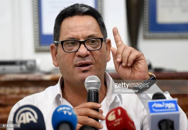 President of the union of Tunisian journalists Neji Beghouri speaks during a press conference on a draft law on the prevention of attacks targeting...