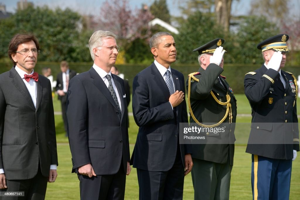 President of the United States <a gi-track='captionPersonalityLinkClicked' href=/galleries/search?phrase=Barack+Obama&family=editorial&specificpeople=203260 ng-click='$event.stopPropagation()'>Barack Obama</a> (C), King Philippe of Belgium and Prime Minister Belgium <a gi-track='captionPersonalityLinkClicked' href=/galleries/search?phrase=Elio+Di+Rupo&family=editorial&specificpeople=743705 ng-click='$event.stopPropagation()'>Elio Di Rupo</a> (L)pay their respects during a visit to the Flanders Field American Cemetery and Memorial on March 26, 2014 in Waregem, Belgium.During his visit to the cemetery, <a gi-track='captionPersonalityLinkClicked' href=/galleries/search?phrase=Barack+Obama&family=editorial&specificpeople=203260 ng-click='$event.stopPropagation()'>Barack Obama</a> paid tribute to the American soldiers who lost their lives during the First World War. The US President is also attending meetings with the European Union's top officials at the European Summit to discuss energy resources, climate change and the situatuion in Ukraine.