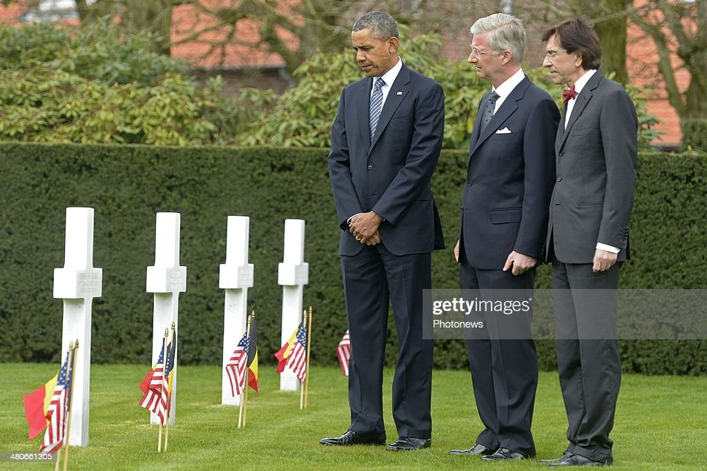 President of the United States Barack Obama, King Philippe of Belgium and Prime Minister Belgium Elio Di Rupo pay their respects during a visit to the Flanders Field American Cemetery and Memorial on March 26, 2014 in Waregem, Belgium.During his visit to the cemetery, Barack Obama paid tribute to the American soldiers who lost their lives during the First World War. The US President is also attending meetings with the European Union's top officials at the European Summit to discuss energy resources, climate change and the situatuion in Ukraine.