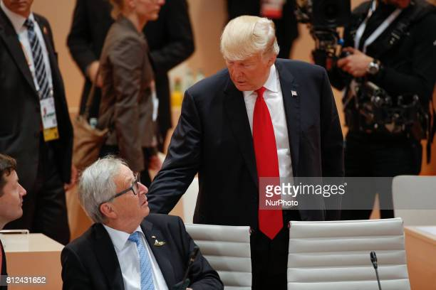 President of the United States Donald Trump is seen greeting European Commission president JeanClaude Juncker ahead of the thrid plenary session of...