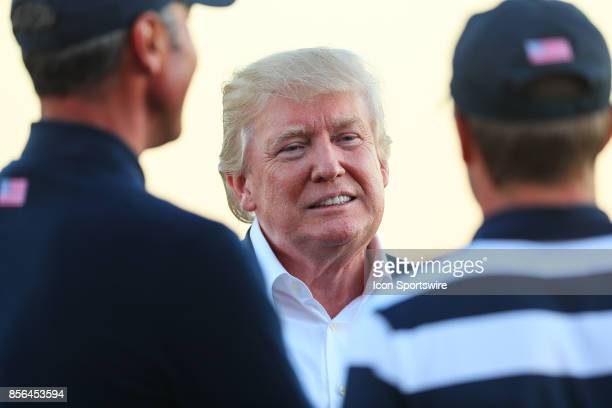 President of the United States Donald Trump talks with Matt Kuchar of the United States after the Presidents Cup on October 1 at Liberty National...