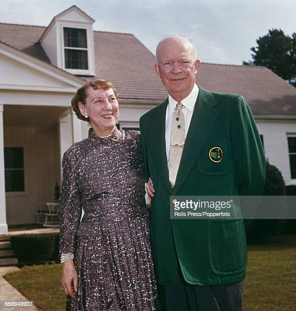 President of the United States Dwight D Eisenhower pictured wearing his green jacket standing with his wife Mamie Eisenhower outside their vacation...
