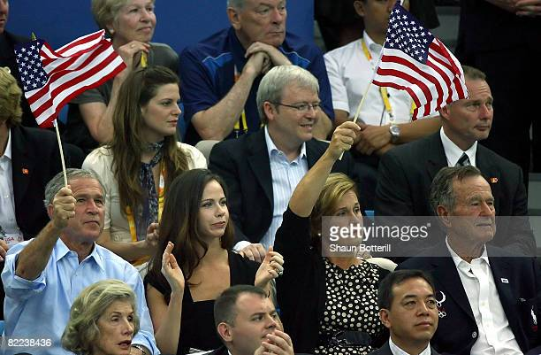 President of the United States George W Bush daughter Barbara Bush and father George H W Bush attend the swimming finals at the National Aquatics...
